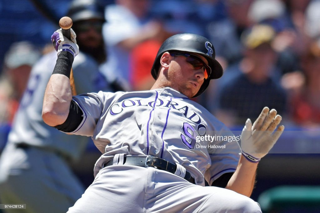 DJ LeMahieu #9 of the Colorado Rockies falls away from an inside pitch during the game against the Philadelphia Phillies at Citizens Bank Park on June 14, 2018 in Philadelphia, Pennsylvania.