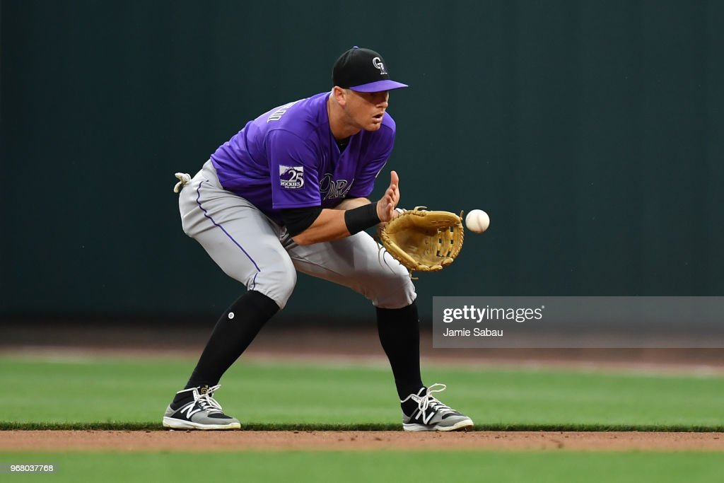 DJ LeMahieu #9 of the Colorado Rockies fields a ground ball in the fourth inning against the Cincinnati Reds at Great American Ball Park on June 5, 2018 in Cincinnati, Ohio.