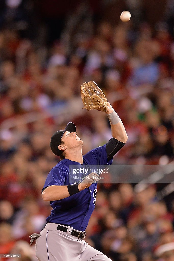 DJ LeMahieu #9 of the Colorado Rockies fields the ball in the seventh inning against the St. Louis Cardinals at Busch Stadium on September 13, 2014 in St. Louis, Missouri. The Cardinals defeated the Rockies 5-4.