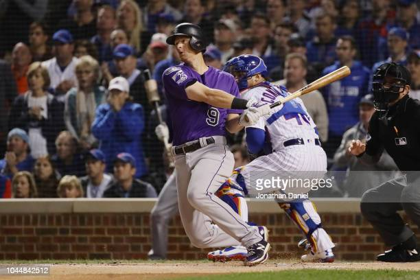 LeMahieu of the Colorado Rockies hits a double in the first inning against the Chicago Cubs during the National League Wild Card Game at Wrigley...