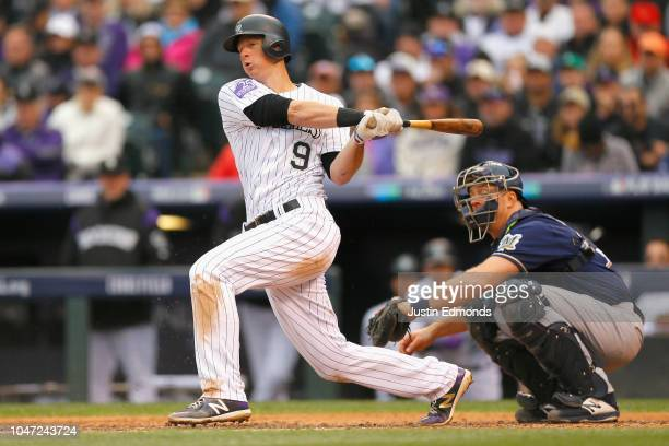 LeMahieu of the Colorado Rockies hits a double in the third inning of Game Three of the National League Division Series against the Milwaukee Brewers...