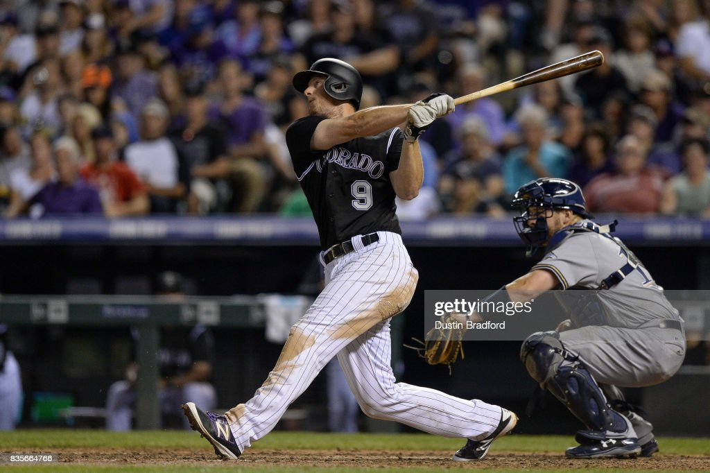 DJ LeMahieu #9 of the Colorado Rockies hits a game-tying RBI single in the seventh inning of a game against the Milwaukee Brewers at Coors Field on August 19, 2017 in Denver, Colorado.