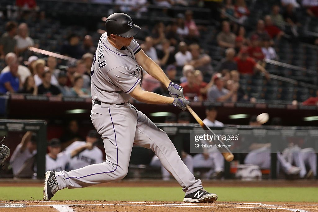 DJ LeMahieu #9 of the Colorado Rockies hits a RBI double against the Arizona Diamondbacks during the first inning of the MLB game at Chase Field on September 13, 2016 in Phoenix, Arizona.