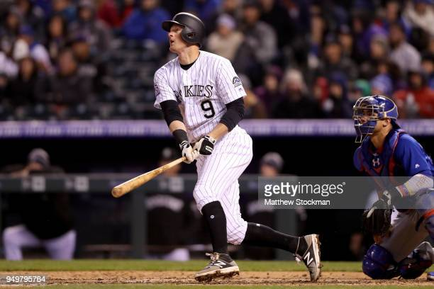 J LeMahieu of the Colorado Rockies hits a RBI double in the fifth inning against the Chicago Cubs at Coors Field on April 21 2018 in Denver Colorado