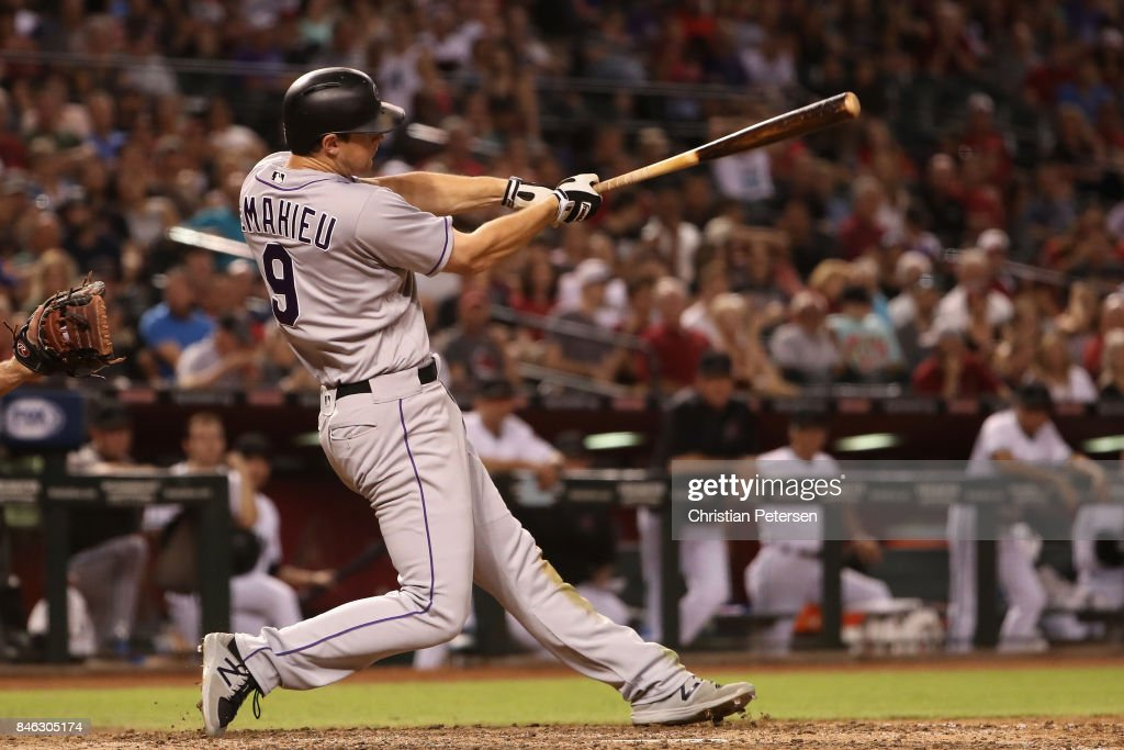 DJ LeMahieu #9 of the Colorado Rockies hits a single against the Arizona Diamondbacks during the seventh inning of the MLB game at Chase Field on September 12, 2017 in Phoenix, Arizona.