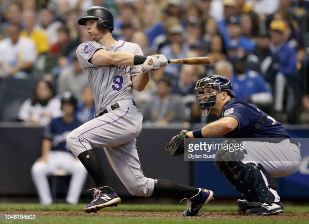 LeMahieu of the Colorado Rockies hits a single during the third inning of Game Two of the National League Division Series against the Milwaukee...