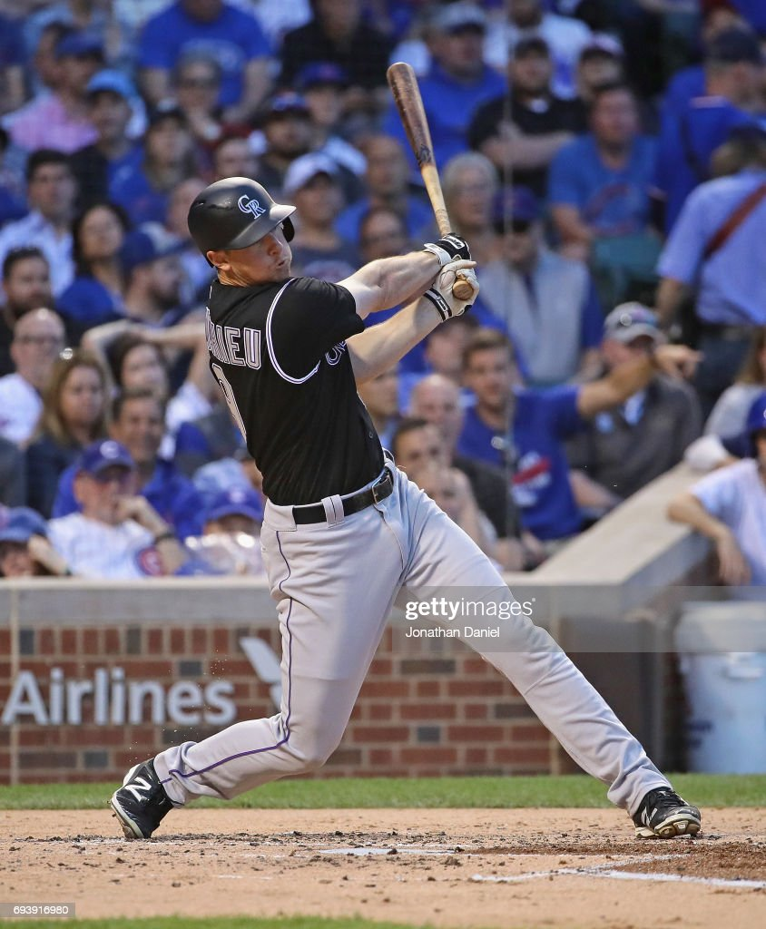 LeMahieu #9 of the Colorado Rockies hits a three run home run in the 2nd inning against the Chicago Cubs at Wrigley Field on June 8, 2017 in Chicago, Illinois.