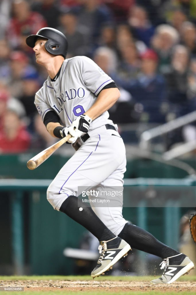DJ LeMahieu #9 of the Colorado Rockies hits a two run home run in the sixth inning inning during a baseball game against the Washington Nationals at Nationals Park on April 12, 2018 in Washington, DC.