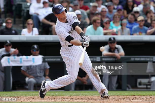 LeMahieu of the Colorado Rockies hits an RBI single to rightfield against the Chicago White Sox to tie the score 4-4 in the sixth inning during...