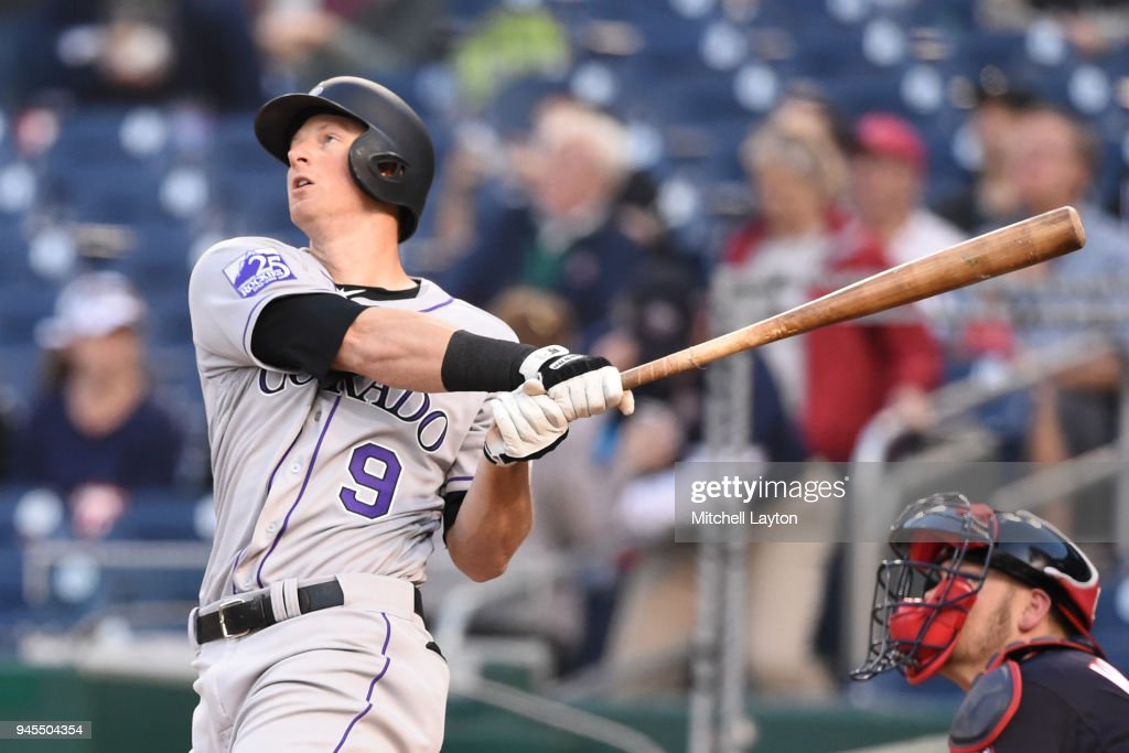 DJ LeMahieu #9 of the Colorado Rockies hits lead off a solo home run in the first inning during a baseball game against the Washington Nationals at Nationals Park on April 12, 2018 in Washington, DC.
