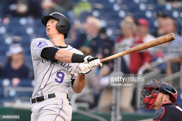 LeMahieu of the Colorado Rockies hits lead off a solo home run in the first inning during a baseball game against the Washington Nationals at...