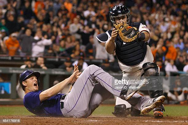 LeMahieu of the Colorado Rockies is tagged out by Andrew Susac of the San Francisco Giants at home plate during the seventh inning at ATT Park on...