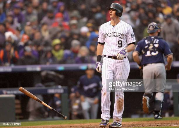 LeMahieu of the Colorado Rockies reacts after striking out in the eighth inning of Game Three of the National League Division Series against the...
