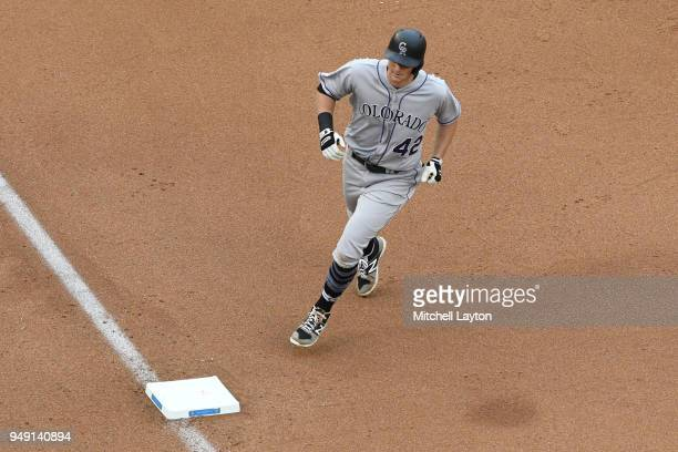 LeMahieu of the Colorado Rockies rounds the bases after hitting a home run during a baseball game against the Washington Nationals at Nationals Park...