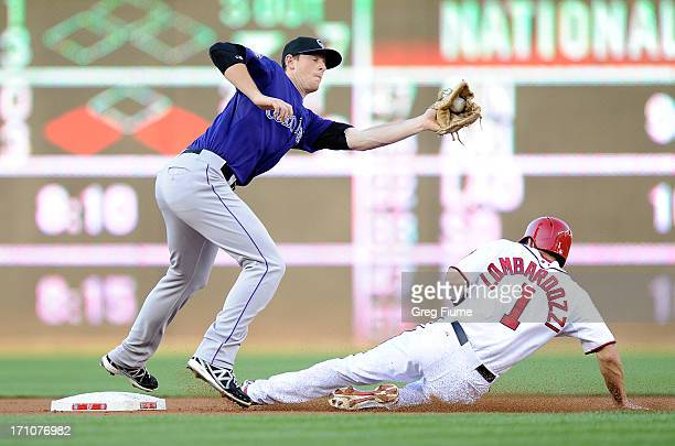 LeMahieu of the Colorado Rockies tags out Steve Lombardozzi of the Washington Nationals trying to steal second base in the second inning at Nationals...