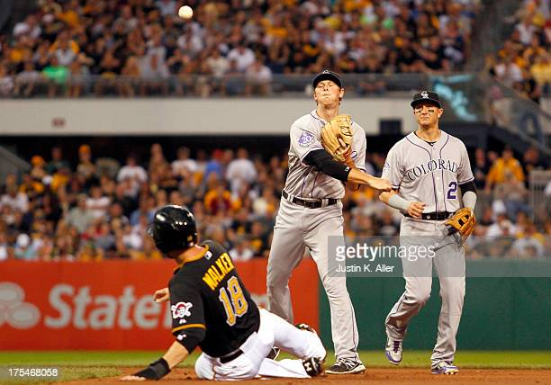 LeMahieu of the Colorado Rockies turns a double play in the fourth inning against the Pittsburgh Pirates during the game on August 3 2013 at PNC Park...
