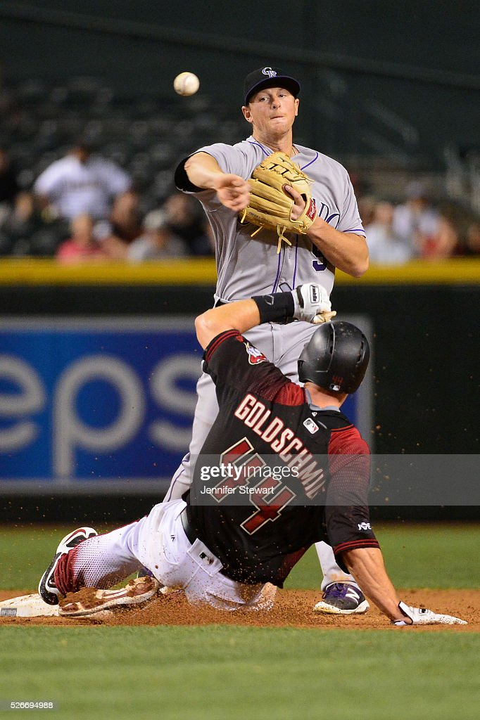 DJ LeMahieu #9 of the Colorado Rockies turns the double play over the sliding Paul Goldschmidt #44 of the Arizona Diamondbacks during the ninth inning at Chase Field on April 30, 2016 in Phoenix, Arizona. The Colorado Rockies won 5-2.