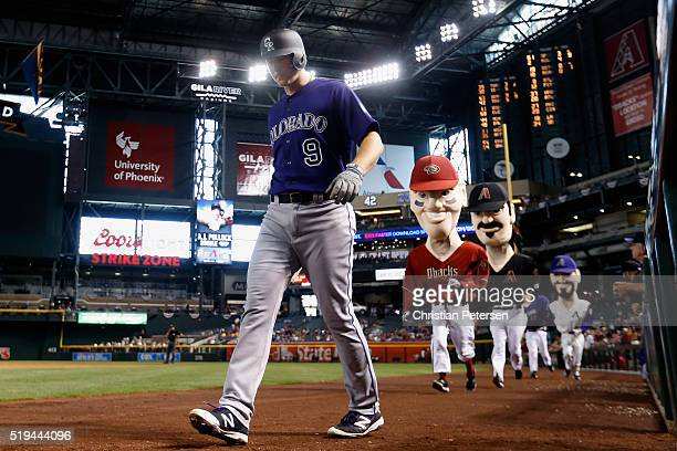 LeMahieu of the Colorado Rockies walks from the dugout as the 'Dbacks Legends' take the field during the fifth inning of the MLB game against the...