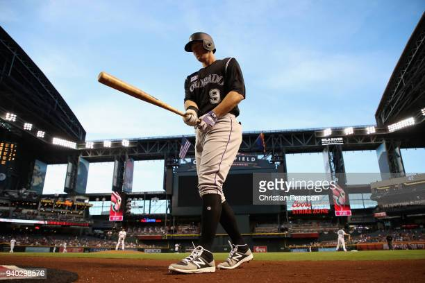 LeMahieu of the Colorado Rockies warms up on deck during the first inning of the MLB game against the Arizona Diamondbacks at Chase Field on March...