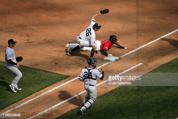 LeMahieu of the New York Yankees attempts to tag out Jackie Bradley Jr #19 of the Boston Red Sox during the MLB London Series game between the New...