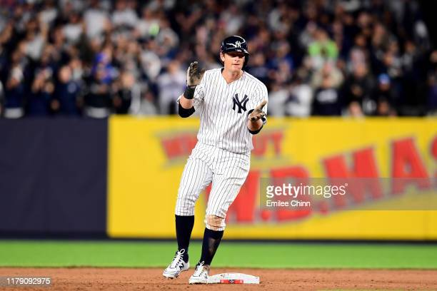 LeMahieu of the New York Yankees celebrates after hitting a double to left field to score Didi Gregorius, Cameron Maybin and Gleyber Torres against...