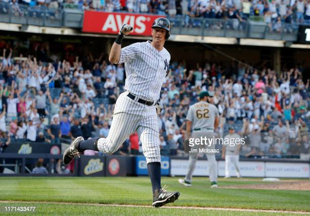 LeMahieu of the New York Yankees celebrates his eleventh inning game winning home run against Lou Trivino of the Oakland Athletics at Yankee Stadium...