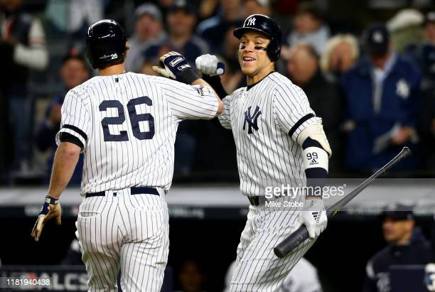LeMahieu of the New York Yankees celebrates with Aaron Judge after hitting a solo home run against Justin Verlander of the Houston Astros during the...