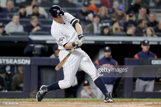 LeMahieu of the New York Yankees hits a a solo home run to right field against Justin Verlander of the Houston Astros during the first inning in game...