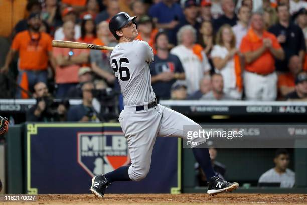 LeMahieu of the New York Yankees hits a gametying tworun home run against the Houston Astros during the ninth inning in game six of the American...