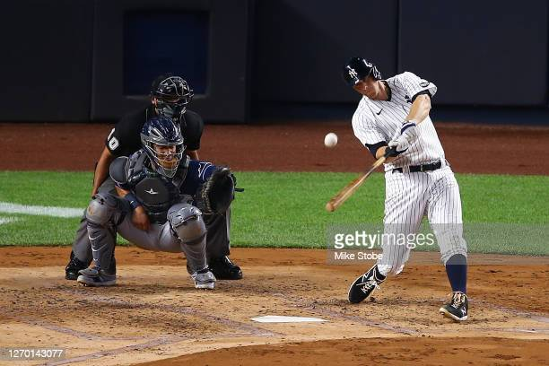 LeMahieu of the New York Yankees hits a home run to right field in the third inning against the Tampa Bay Rays at Yankee Stadium on September 01,...