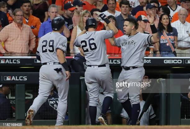 LeMahieu of the New York Yankees is congratulated by his teammates Gio Urshela and Gary Sanchez after his gametying tworun home run against the...