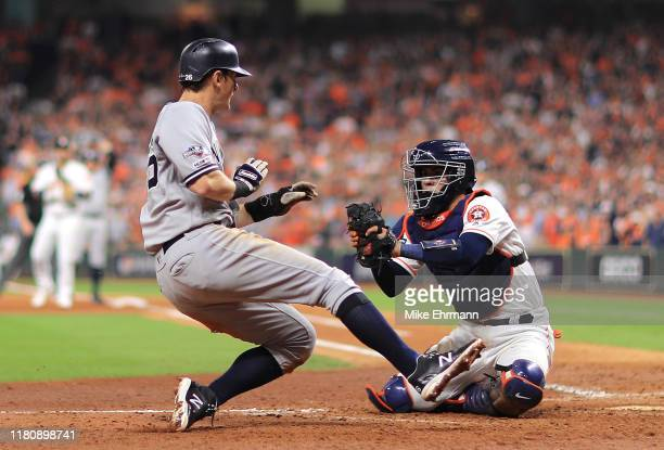 LeMahieu of the New York Yankees is tagged out at home plate by Robinson Chirinos of the Houston Astros during the sixth inning in game two of the...
