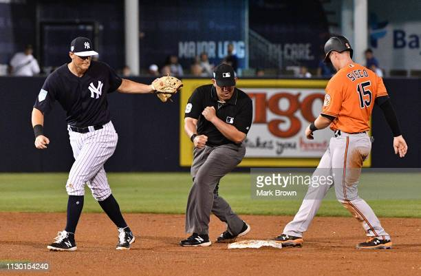 LeMahieu of the New York Yankees makes the out of Chance Sisco of the Baltimore Orioles in the fifth inning during the spring training game at...