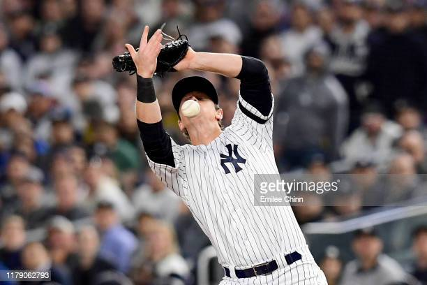 LeMahieu of the New York Yankees misses a catch hit a by C.J. Cron of the Minnesota Twins during the second inning in game one of the American League...