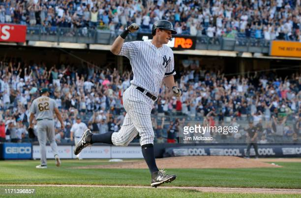 LeMahieu of the New York Yankees reacts after his eleventh inning game winning home run against Lou Trivino of the Oakland Athletics at Yankee...