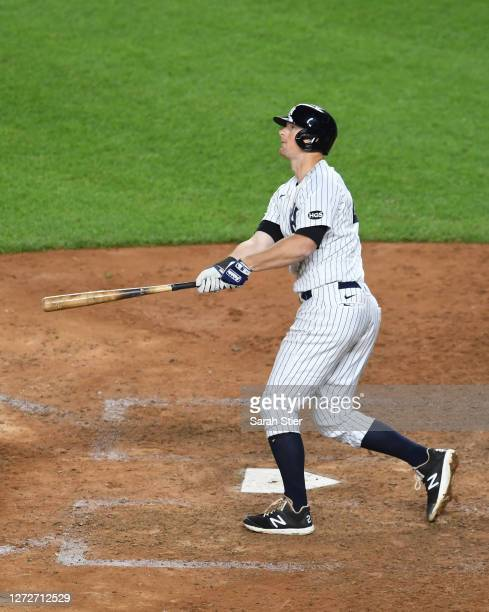 LeMahieu of the New York Yankees reacts after hitting a home run during the eighth inning against the Toronto Blue Jays at Yankee Stadium on...