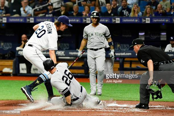 LeMahieu of the New York Yankees scores after a passed ball error committed by Nick Ciuffo of the Tampa Bay Rays in the first inning at Tropicana...