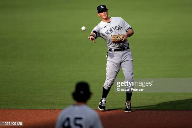 LeMahieu of the New York Yankees throws out the runner against the Tampa Bay Rays during the first inning in Game Five of the American League...