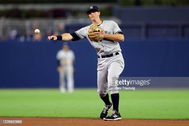 LeMahieu of the New York Yankees throws to first base for the out during Game 2 of the ALDS between the New York Yankees and the Tampa Bay Rays at...