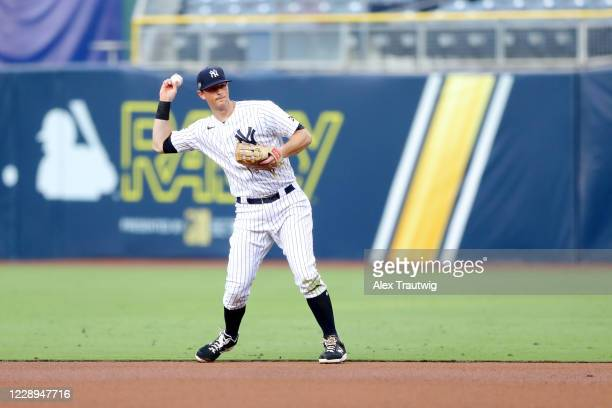LeMahieu of the New York Yankees throws to first base for the out during Game 3 of the ALDS between the New York Yankees and the Tampa Bay Rays at...