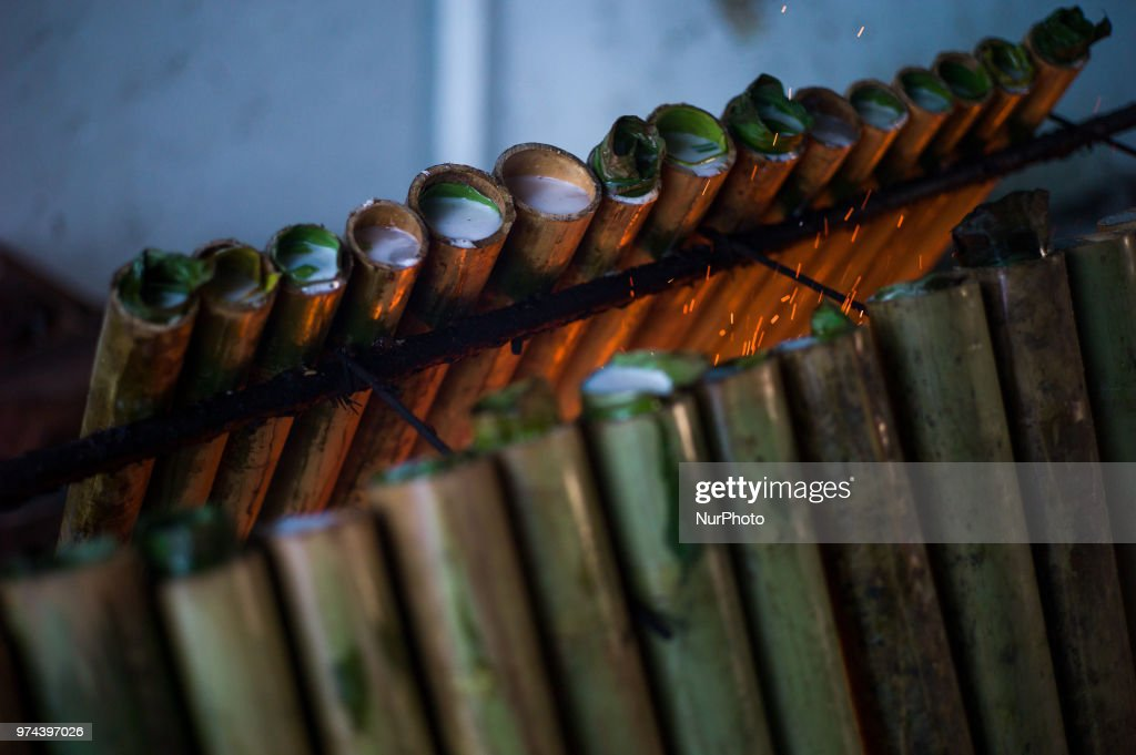 'Lemang' is a traditional food made of glutinous rice, coconut milk and salt, cooked in a hollowed bamboo stick lined with banana leaves in order to prevent the rice from sticking to the bamboo for the Eid al-Fitr celebration in Kuala Lumpur, Malaysia on June 14, 2018. Eid al-Fitr is an important religious holiday celebrated by Muslims worldwide that marks the end of Ramadan, the Islamic holy month of fasting.