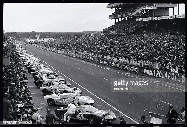 Lemans NI Starting of Le Mans 24 hours car race for 1966 Racers rusk at their bolides