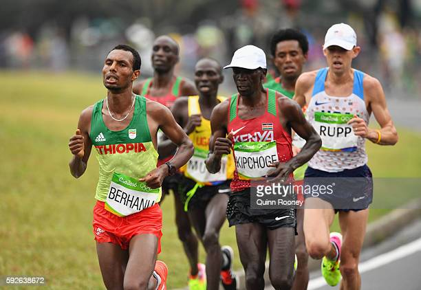 Lemi Berhanu of Ethiopia and Eliud Kipchoge of Kenya compete during the Men's Marathon on Day 16 of the Rio 2016 Olympic Games at Sambodromo on...