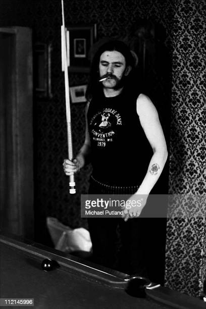 Lemmy Kilmister of Motorhead portrait playing pool 1982
