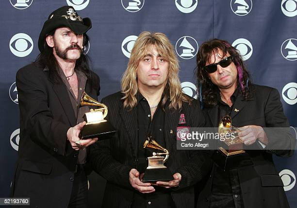 Lemmy Mikkey Dee and Phil Campbell of Motorhead pose backstage with their award for Best Metal Performance during the 47th Annual Grammy Awards at...