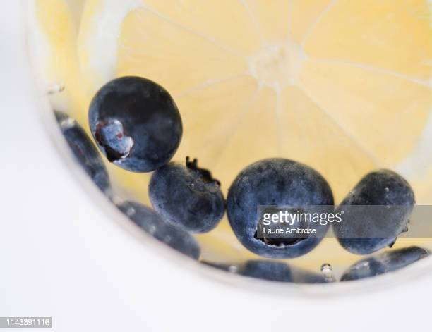 lemon and blueberry infused water - infused stock pictures, royalty-free photos & images