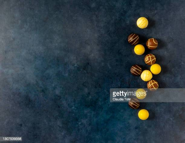lemon and chocolate truffles on blue background - cipriani manhattan stock pictures, royalty-free photos & images
