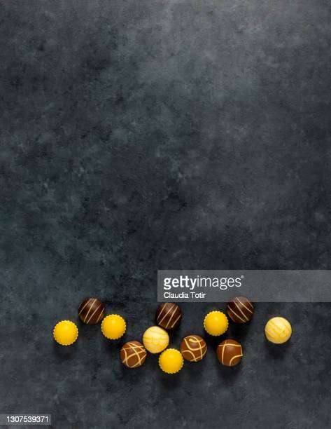 lemon and chocolate truffles on gray background - cipriani manhattan stock pictures, royalty-free photos & images