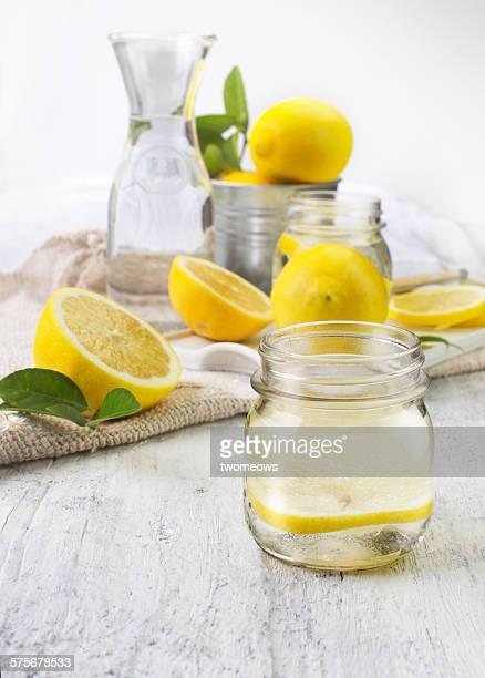 Lemon and lemon water in glass