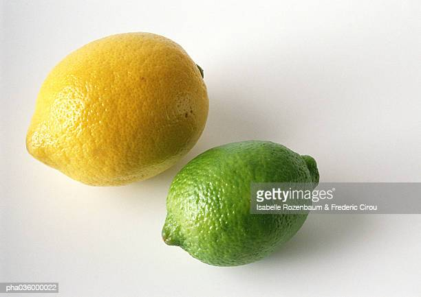 Lemon and lime, close-up, white background